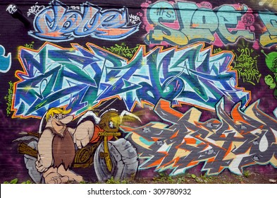 MONTREAL,CANADA QUEBEC AUGUST 22 2015: Street art  Barney Rubble Montreal is the perfect place to walk in the back alleys and abandoned areas, looking for street art.