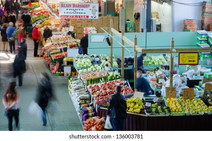 MONTREAL-CIRCA APRIL 2013: People buy groceries at Jean-Talon Market, the largest outdoor public market in North America. Circa April 2013, in Montreal