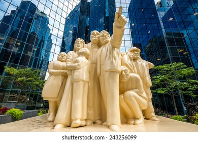 Montreal,Quebec,Canada- August-16-2012: The Illuminated Crowd is a public sculpture, made in 1985 by artist Raymond Mason from stratified polyester resin with polyurethane paint.