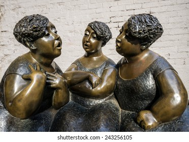Montreal,Quebec,Canada- November-12-2012: Les chuchoteuses (The Gossipers) on rue Saint-Paul, Montreal, Canada  It is a Bronze Figurative Public Sculpture created in 2002 by Rose Aimee Belanger
