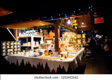 Montreux, Switzerland. 7th December 2018. Vibrant colours of the market stalls and festivities of the Montreux Christmas Market at night