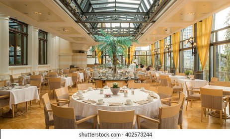 Montreux, Switzerland - April 6, 2016: Interior of Breakfast restaurant with big windows, glass roof in Fairmont Le Montreux Palace 5 stars Luxury Hotel Resort Spa in the morning