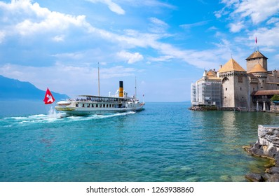 Montreux, Switzerland - August 13, 2015:  A boat with tourits reaching the Chillon castle on the Leman lake