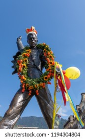 MONTREUX, Switzerland - September 9 2018: Queen fans pay homage to Freddy Mercury with flowers and ballons at his statue at the shoreline of Montreux. Mercury lived in Montreux 1979-1991