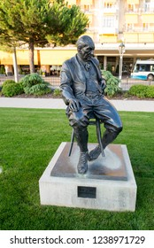 Montreux/Switzerland - August 28 2015: Bronze Statue to Vladimir Nabokov a Russian-American novelist, in the gardens of the Montreux Palace in Montreux