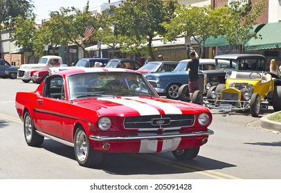 MONTROSE/CALIFORNIA - JULY 6, 2O14: Classic1962 Ford Mustang Fastback 2+2 owned by Nick Sfetko as it departs the Montrose Hot Rod & Classic Car Show. July 6, 2014 Montrose, California USA