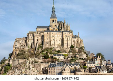 MONT-SAINT-MICHEL, FRANCE - FEBRUARY 22, 2020. The architecture of Mont-Saint-Michel and its bay make it the most visited tourist site in Normandy and one of the ten most visited in France.