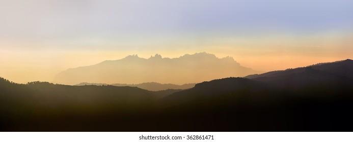 Montserrat mountains floated at dusk of a warm light sunset