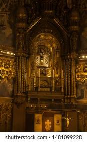 Montserrat, Spain, June 23, 2019: Interior of the Basilica of Montserrat in Spain with the statue of the Black Madonna during the liturgy