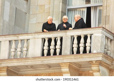 MONTSERRAT, SPAIN - OCTOBER 07, 2013: Monks are on balcony in Montserrat Benedictine monastery, religious center of Catalonia, Montserrat, Spain. Monks rarely appear in public