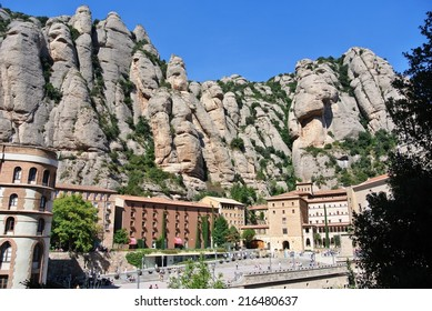 MONTSERRAT, SPAIN - SEPTEMBER 22, 2013: Benedictine abbey Santa Maria de Montserrat, located high in the Montserrat mountain, which is a popular hiking and climbing spot for both locals and tourists.