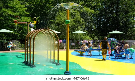 MONTVILLE, CT - JUN 18: Splash pad at the Dinosaur Place at Nature's Art Village in Montville, Connecticut, as seen on Jun 18, 2016. The park features over 40 life-sized dinosaurs.