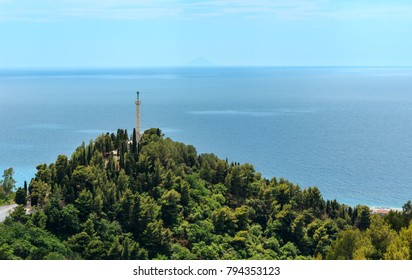 Monument with cross on mountain hill top near old Belmonte Calabro town, province of Cosenza and island in far, Calabria, Italy, Tyrrhenian sea.