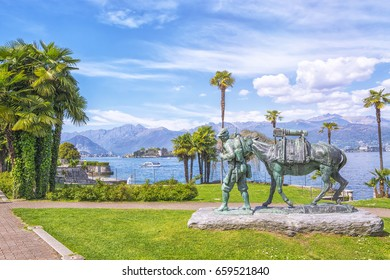 Monument to the dead alpine shooters, residents of Stresa. Resort town of Stresa on the shores of Lake Lago Maggiore in background of the Alps Mountains, Piedmont, Italy.