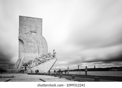 Monument to the Discoveries (Pedrao dos Descobrementos) on the North bank of the Tagus River in Lisbon, Portugal, with the 25th of April Bridge in the background. Long exposure.