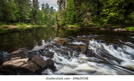 Monument Falls along the Ausable River in Lake Placid, new York on a summer morning.