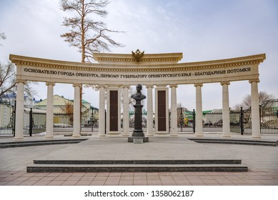 Monument to Governor Neplyuev. Orenburg, Russia - April, 2, 2019: Sovetskaya Street. Monument to founder of city, first governor of Orenburg region Neplyuev. Bust on background of colonnade