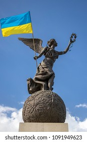 Monument of Independence. Nika the goddess on a ball with a flag of Ukraine in hands on a background of the sky. City center. May 2018, Kharkiv, Ukraine