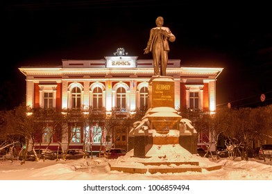 Monument to Lenin in Vladimir, Russia adjacent to the bank.
