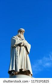 Monument to Leonardo Da Vinci with his statue on Piazza Della Scala in Milan, Italy.