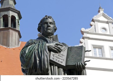 Monument of Martin Luther in Wittenberg, Germany. It was the first public monument of the reformer, designed 1821 by J. G. Schadow. Luther  was a monk and church reformer, the translator of the bible