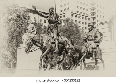 Monument of Miguel Cervantes (1930) on Plaza de Espana in Madrid, Spain. The writer is accompanied by Don Quijote and Sancho Panza. Antique vintage.