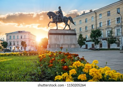 Monument to Mikhail Tverskoy on horseback on Sovetskaya Square in Tver and flowerbed on a sunny summer evening