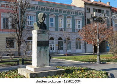 Monument national hero Zarko Zrenjanin on the building background City Library, Serbia, Vojvodina town of Vrsac, December 9, 2018