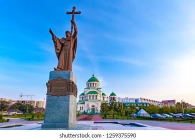 """Monument on the square in the city in front of the Christian church, Translation: """"To the Holy Equal-Apostolic Prince Vladimir the Baptist of Russia"""". Saint Vladimir Cathedral, Astrakhan, Russia."""
