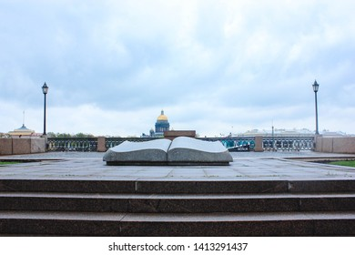 The monument is an Open book. Russia, St. Petersburg, University embankment. Monument in the form of an open book. Monument on the Neva river embankment. April, 2019