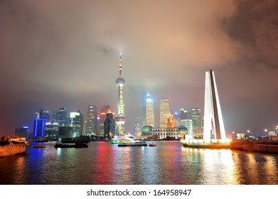 The Monument to the People's Heroes and shanghai skyline at night