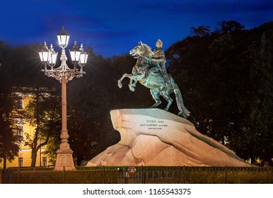 Monument to Peter the Great on the Senate Square in St. Petersburg, a summer white night and a lantern