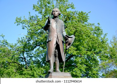 Monument to the philosopher Immanuel Kant against the background of foliage. Kaliningrad