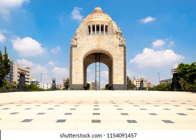 The Monument to the Revolution in Mexico City - Designed in 1897 (with unrecognizable people)