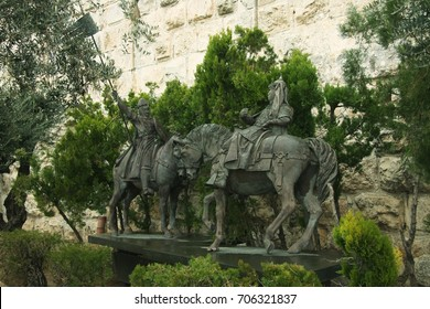 Monument to  Richard I and Saladin. Israel, Jerusalem January: The monument to military men Richard I and Salladin at the fortress wall of the old city. Bronze monuments, greenery, wall.
