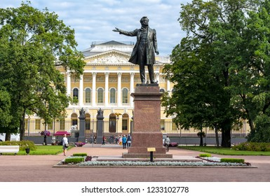 Monument to Russian poet Alexander Pushkin on Culture square and Russian museum at background, St. Petersburg, Russia