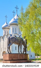 Monument to  Russian poet Konstantin Batyushkov against backdrop of  ancient St. Sophia Cathedral in Vologda. Russia, Vologda. May 10, 2019