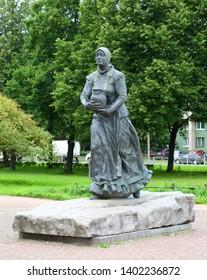 Monument saleswoman milk from the area of the Okhta river Sredneohtinskiy prospekt St. Petersburg Russia August 2018