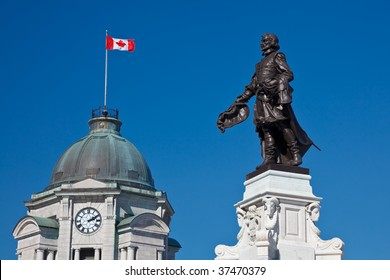 Monument to Samuel De Champlain, founder of the Quebec City with the old Post Office tower in the back, Place D'Armes, Quebec City, Canada