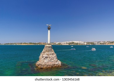 Monument to the scuttled ships in the blue sea in Sevastopol