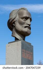 "Monument to Soviet geologist Yuri Alexandrovich Bilibin (1901-1952), Magadan, Magadan Region, Russia - May 12, 2021. Sculptural portrait on a pedestal. Text in Russian ""Yuri Alexandrovich Bilibin""."