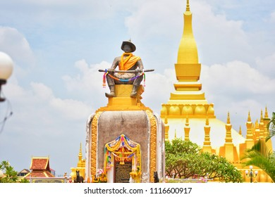 Monument statue of King Chao Anouvong with Pha That Luang stupa at background.June 20,2018 : Vientiane,Laos.