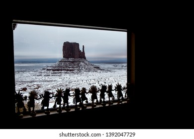 Monument Valley, Arizona / USA - December 12, 2018: Hopi Kotsinas statues from a tourist store looking at Monument Valley