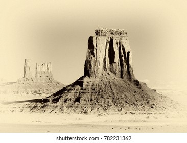 Monument Valley in high desert Four Corners Area of Arizona at dawn. Modern photograph given a vintage look.