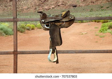 Monument valley and horse saddle on fence, landscape at morning, USA