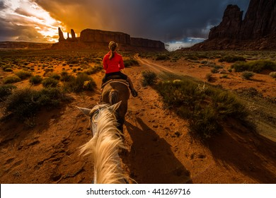 Monument Valley Horseback Riding First person view from the horse with sunset sky over the three sisters