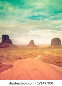 Monument Valley national park with retro processing. Desert Sunset