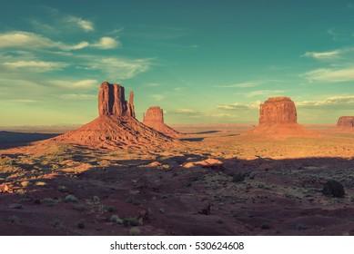 Monument Valley at sunset, Arizona. Vintage processed.
