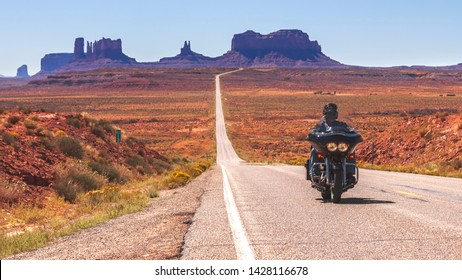 MONUMENT VALLEY, UTAH - SEPTEMBER 22, 2010:  Biker  ride through a desert Monument valley road. Monument Valley Navajo Tribal Park covers 130,000 square miles on the Colorado plateau.