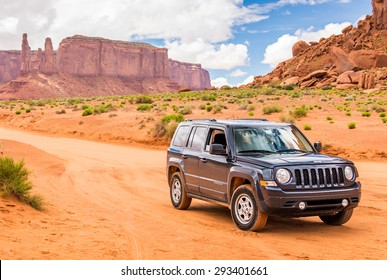 MONUMENT VALLEY, UTAH, USA - MAY 25, 2015 - Offroading through the Monument Valley in Jeep Patriot. Jeep Patriot  is sport utility vehicle (SUV), manufactured by American automaker Chrysler.